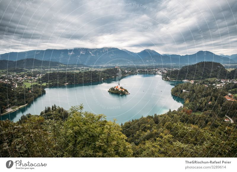 Lake Bled Nature Landscape Blue Gray Green White Slovenia Mountain Tree Town Island Clouds Colour photo Deserted Copy Space top Copy Space bottom