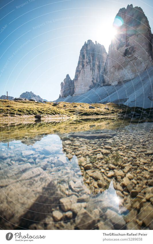 Tre Cime against the light - mountains reflected in the small lake Lake Water Calm Hiking Mountain Tre Cime di Lavaredo popular Tourism Climbing Back-light