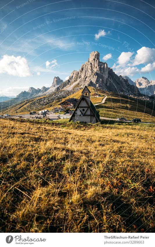 Church on the Passo di Giau South Tyrol Mountain Clouds Landscape Light mountains Evening Sun Nature Blue Grass Sky Meadow Exterior shot Street pass road Green