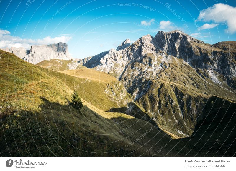 Mountain panorama on the Passo di Giau Clouds Landscape Light mountains Evening Sun Nature Blue Grass Sky Meadow Exterior shot Green Summer Hill Vantage point