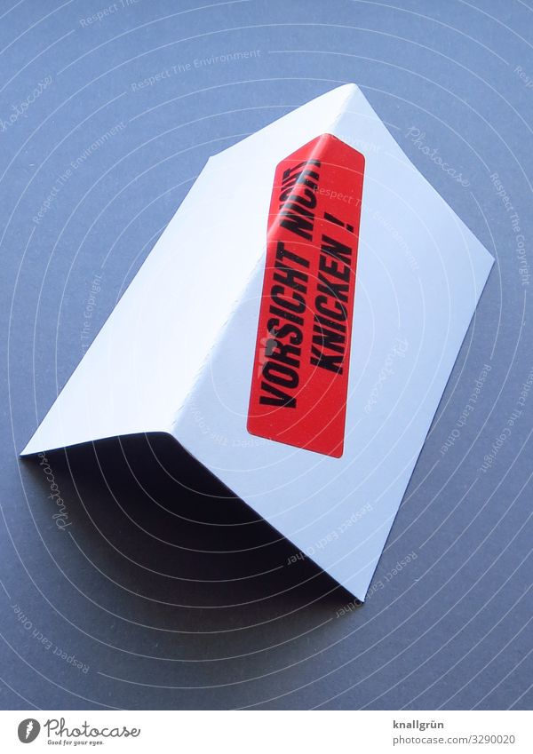 CAUTION DO NOT BEND ! Characters Signs and labeling Signage Warning sign Communicate Sharp-edged Gray Red Black White Cardboard Label Bend Colour photo