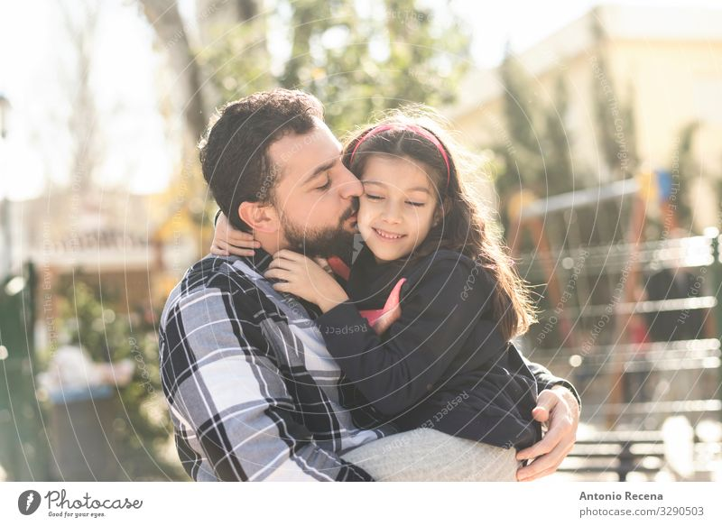 father kissing daughter Lifestyle Child Human being Man Adults Parents Father Family & Relations Park Beard Kissing Smiling Love Embrace Daughter embracing