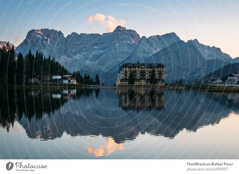 Lago di Misurina - Reflection in the lake Lake mirror mountain Mountain bank evening mood Sunset South Tyrol Blue reflection Clouds houses