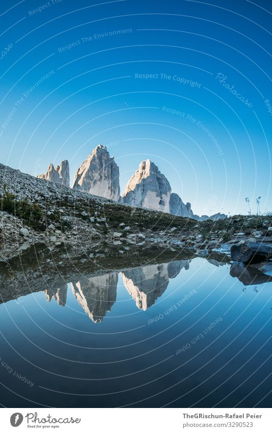 Tre Cime di Lavaredo - Mountains reflected in the small lake Lake Water Calm Hiking popular Tourism Climbing touristic reflection South Tyrol Blue sky