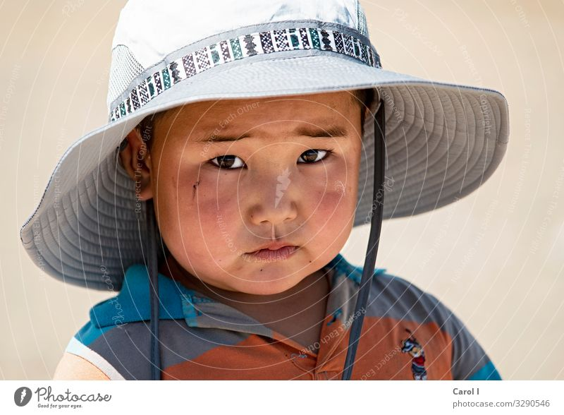 sunny boy Masculine Child Toddler Boy (child) Head Eyes Nose Mouth 1 Human being 1 - 3 years Nature Mongolia Asia T-shirt Hat Sunhat Black-haired Looking