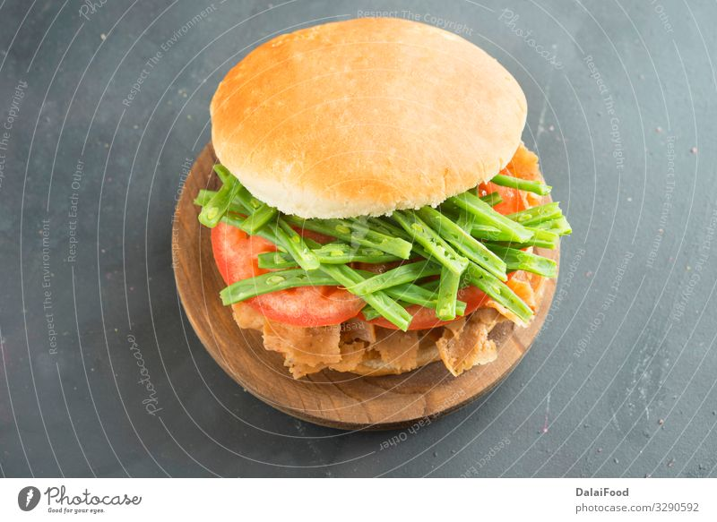 Chacarero Sandwich typical of chilean cuisine Food Meat Appetite black background chopped gren beans slices of meat Tomato wooden plate Bird's-eye view