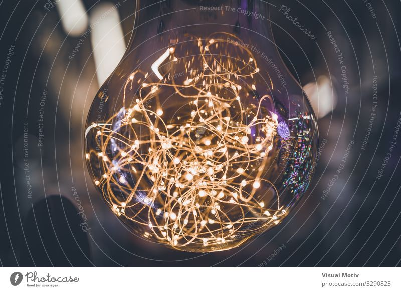 Giant light bulb with light garlands inside Technology Entertainment electronics Advancement Future Work of art Lightning Collection Collector's item Glass