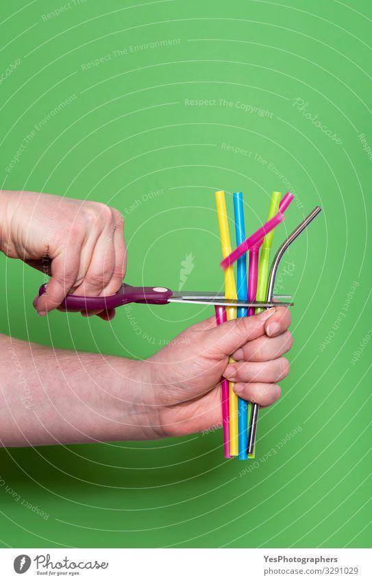 Cutting plastic straws Metal drinking straw Reduce plastic waste Straw Lifestyle Scissors Hand Environment Sustainability Green Environmental pollution