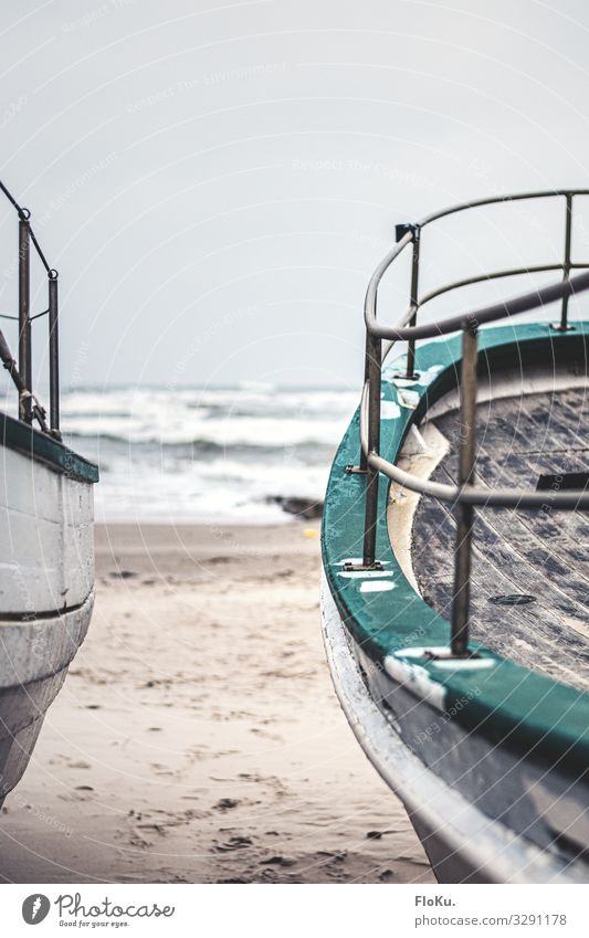 rail Vacation & Travel Tourism Beach Ocean Sand Water Coast North Sea Navigation Fishing boat Old Retro Gray Green Nostalgia Railing Wood Watercraft