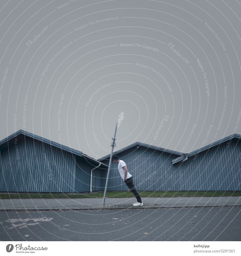 strange thing in sønderborg Human being Masculine Man Adults Body 1 45 - 60 years Village Fishing village Hut Roof Stand Wooden stake Crazy Tilt Wooden hut