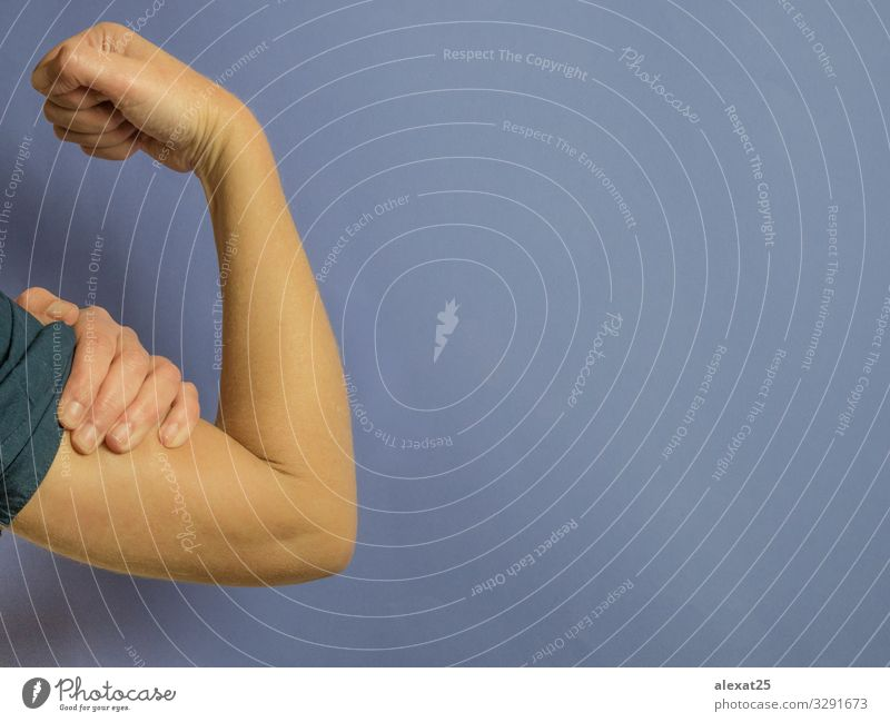 Woman´s arm as a sign of strength purple background Adults Feasts & Celebrations Copy Space Earth Work and employment Arm Signage Symbols and metaphors Strong