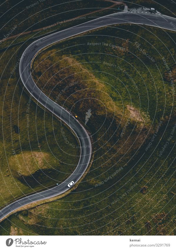 S-curve: road with car from above Landscape Street Meadow Transport Car Road traffic Green Motoring Bird's-eye view droning Curve tranquillity Idyll England
