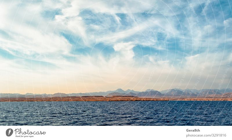 rocky coast of the Red Sea andblue sky with clouds Exotic Vacation & Travel Tourism Trip Summer Ocean Nature Landscape Sand Sky Clouds Horizon Climate Rock