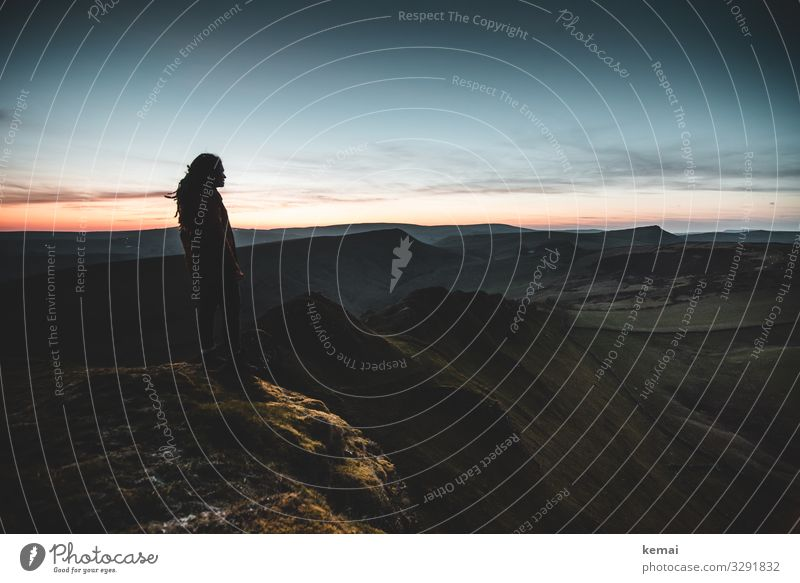 Woman on hill shortly after sunset, looking into the distance Lifestyle Harmonious Well-being Contentment Senses Relaxation Calm Leisure and hobbies Adventure