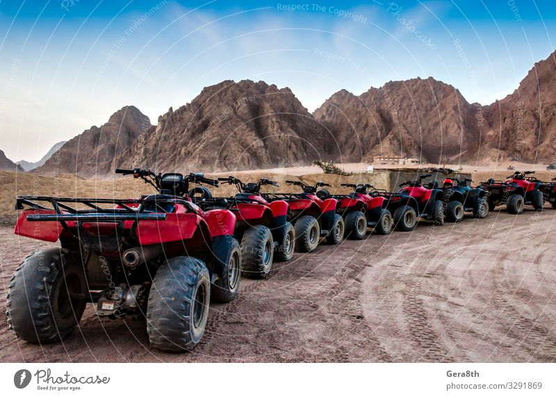 series of ATVs on the background of mountains in the desert Summer Mountain Machinery Sand Sky Rock Transport Street Stone Blue Red Egypt Sharm El Sheikh