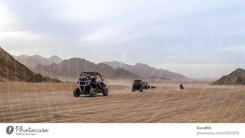 trip of tourists to the desert on the offroad buggy in Egypt Sky Vacation & Travel Summer Blue Landscape Relaxation Clouds Mountain Street Lanes & trails