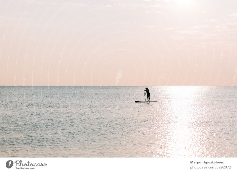 Man riding a board on the sea in sunset Lifestyle Joy Athletic Fitness Harmonious Leisure and hobbies Vacation & Travel Tourism Adventure Freedom Summer