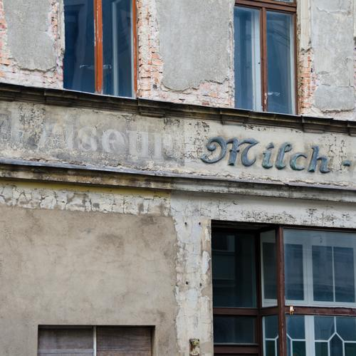 Hairdresser milk and the time Trade lost places goerlitz Facade Window Word Old Authentic Historic Gray Style Past Transience Ravages of time Weathered Vacancy