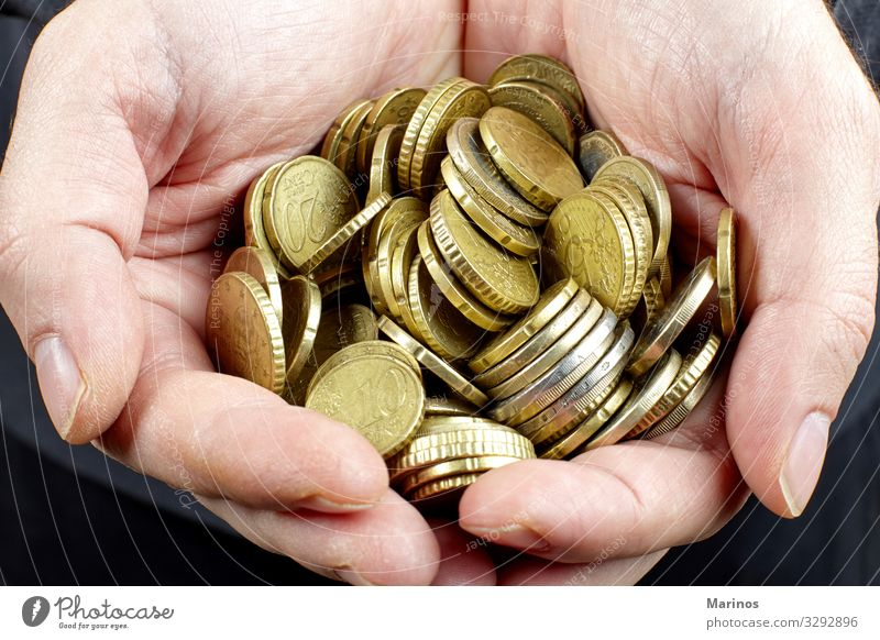 Hands holding Euro coins Money Economy Financial Industry Financial institution Business Success Man Adults Arm Metal To hold on Gold Might euro Accumulation