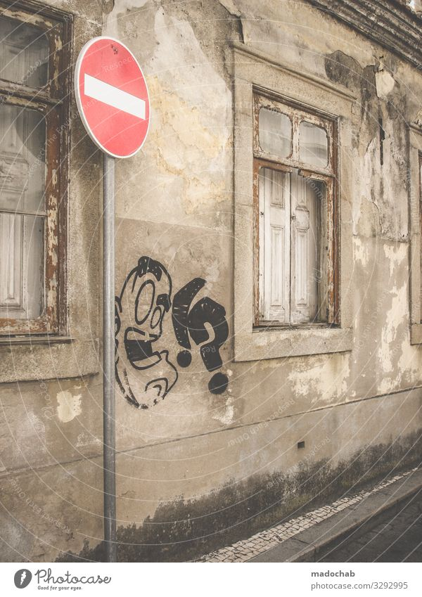 Urban image Graffiti Facade urban Town Wall (building) Window Architecture built Manmade structures Wall (barrier) Exterior shot Deserted Gloomy Old Gray