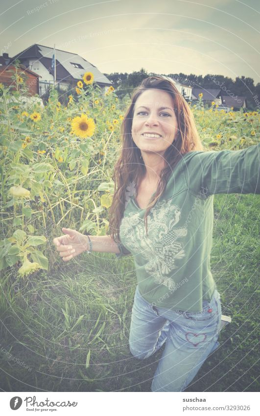 woman making a selfie in front of a sunflower meadow Woman Hippie long hairs flower girl feminine Selfie Meadow Flower meadow Sunflowers Place
