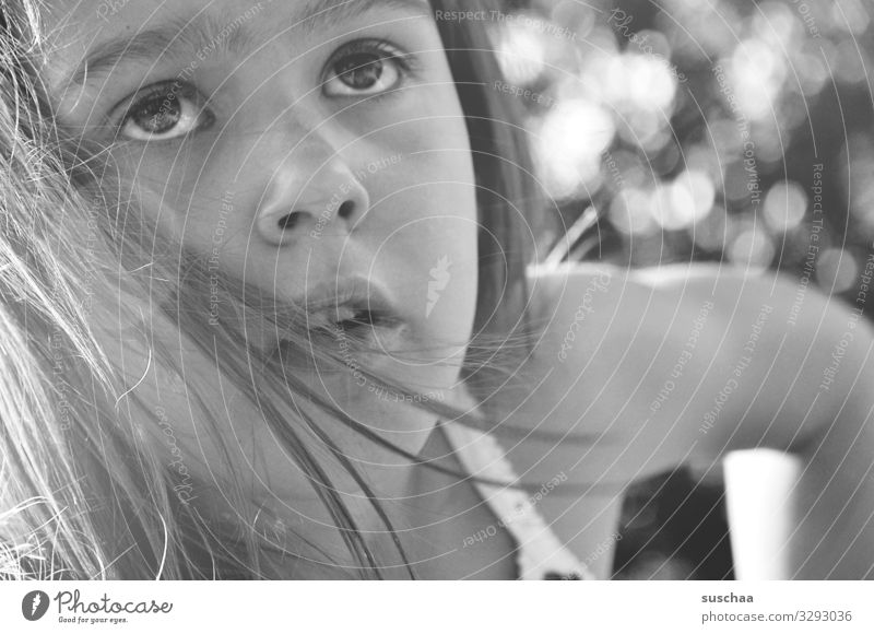 childhood Child Girl Portrait photograph Face Black & white photo Hair and hairstyles Summer Exterior shot Arm Eyes Nose Mouth Looking Blur Sunlight Upward