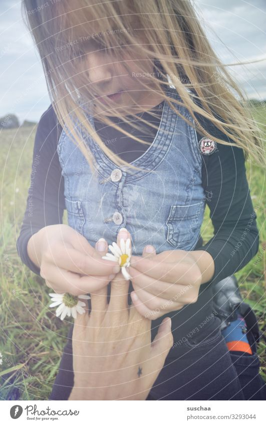ring of daisies .. Child Girl Infancy Hair and hairstyles Wind Exterior shot Flower Flower meadow Daisy Marguerite Chamomile Meadow flower Hand Fingers Ring