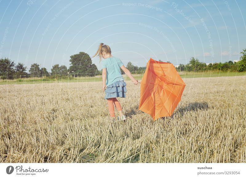 my umbrella is broken Field straw field cereal fields Stubble field Nature Landscape Summer Child Girl Infancy Umbrella Broken Orange Exterior shot Whimsical