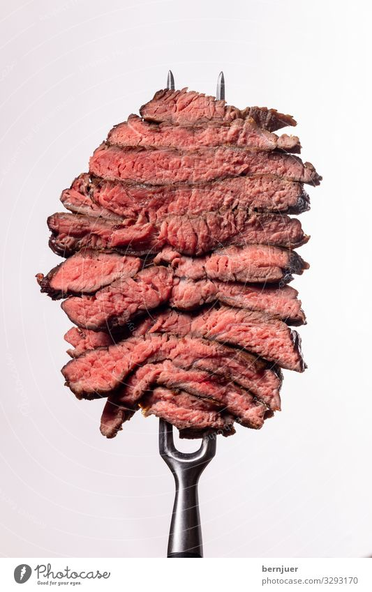 Steak slices Meat Dinner Fork Media Stone Dark Thin Juicy Red Black White Quality Butcher barbecue Rib eye steak Fat BBQ Seldom Background picture segregated