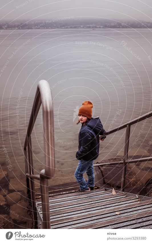 Boy stands at stairs to lake Lifestyle Leisure and hobbies Human being Masculine Child Boy (child) Infancy Youth (Young adults) 1 8 - 13 years Environment