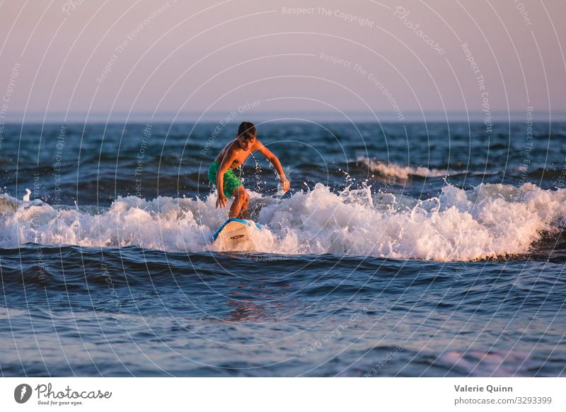 Learning to Surf Surfing Vacation & Travel Summer Summer vacation Beach Ocean Waves Surfboard Boy (child) 1 Human being 8 - 13 years Child Infancy