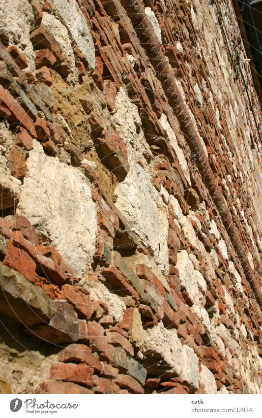 masonry Old town House (Residential Structure) Wall (barrier) Wall (building) Facade Stone Brick Dirty Historic Red Perspective Derelict Colour photo