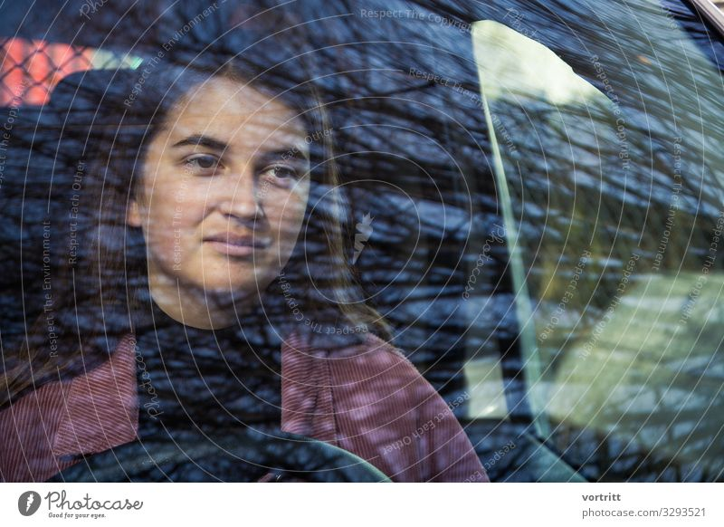 behind Tree Life Car Driving Woman Steering wheel Reflection Window Young woman Colour photo Exterior shot Structures and shapes Looking