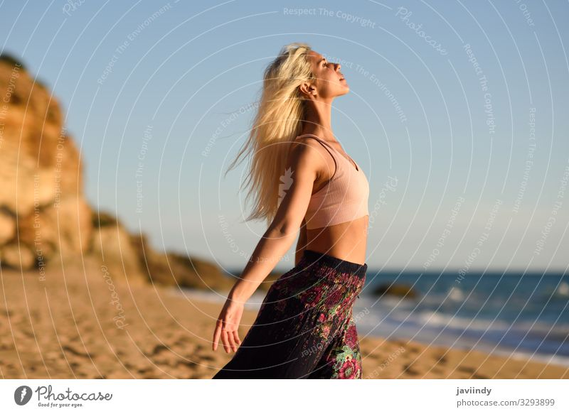 Woman enjoying the sunset on a beautiful beach Human being Sky Vacation & Travel Nature Youth (Young adults) Young woman Summer Beautiful Sun Ocean Relaxation