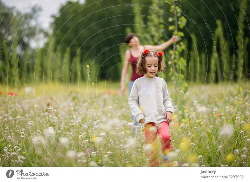 Mother with her little daughter in poppy field Lifestyle Joy Happy Beautiful Playing Child Human being Feminine Baby Woman Adults Parents Family & Relations