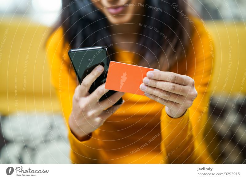 Woman shopping with smartphone paying with her credit card Lifestyle Shopping Money Decoration Financial Industry Financial institution Business Telephone PDA