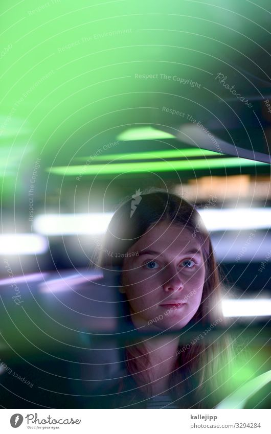 Girl looks into the camera under neon light Computer Notebook Screen Technology Entertainment electronics Science & Research Advancement Future High-tech