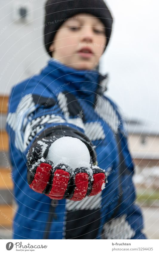 snowball fight Life Leisure and hobbies Playing Vacation & Travel Parenting Child Schoolyard Boy (child) 1 Human being Winter Jacket Gloves Cap Touch To hold on