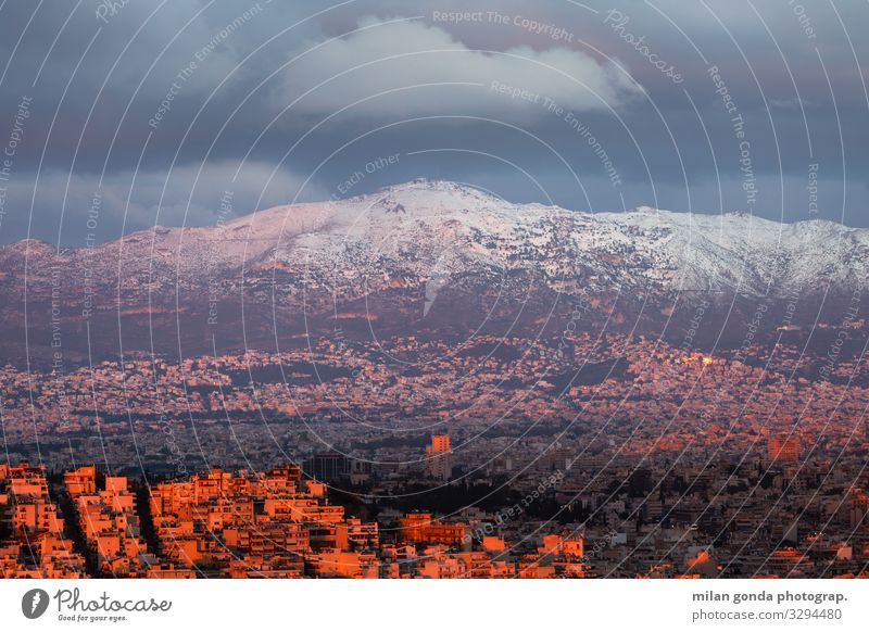Athens. Winter Snow Mountain Cold Europe Mediterranean Greece Greek Attica Lycabettus cityscape Sunset Pentali Pentalicus City Evening