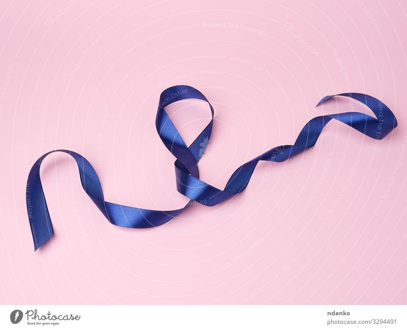 blue silk thin ribbon twisted on a pink background Design Decoration Feasts & Celebrations Christmas & Advent Birthday Tool Cloth Curl Line Blue Pink Colour