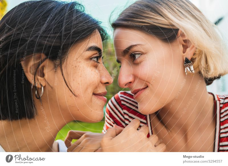 Loving lesbian couple having a date. Lifestyle Happy Leisure and hobbies Freedom Homosexual Woman Adults Couple Love Embrace Happiness Together Romance