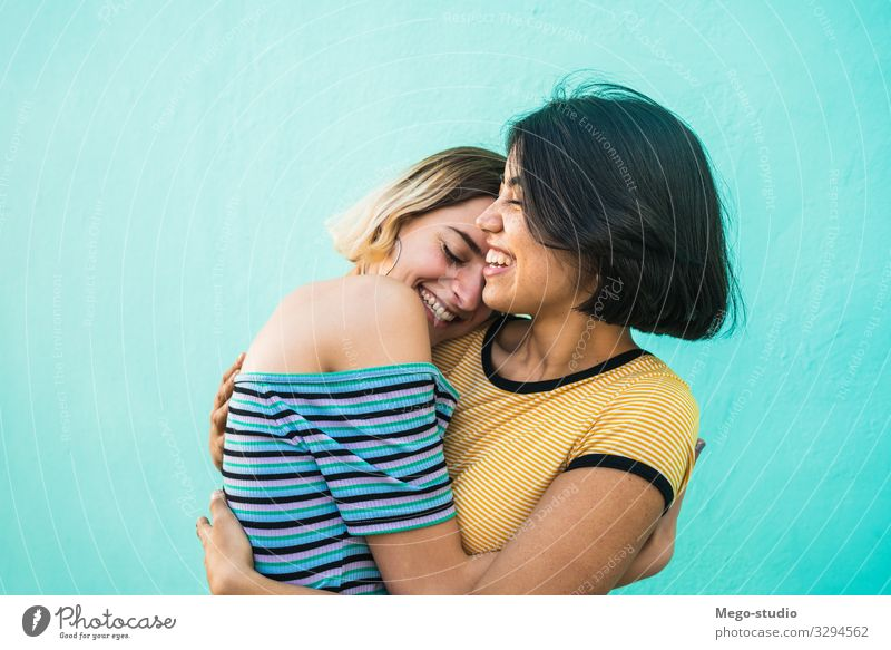 Loving lesbian couple hugging. Lifestyle Happy Leisure and hobbies Freedom Homosexual Woman Adults Couple Love Embrace Happiness Together Romance Relationship