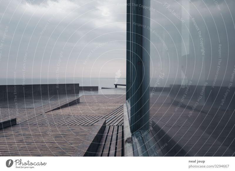Vacation & Travel Nature Ocean Loneliness Calm Beach Window Dark Wood Wall (building) Coast Wall (barrier) Gray Rain Horizon Glass