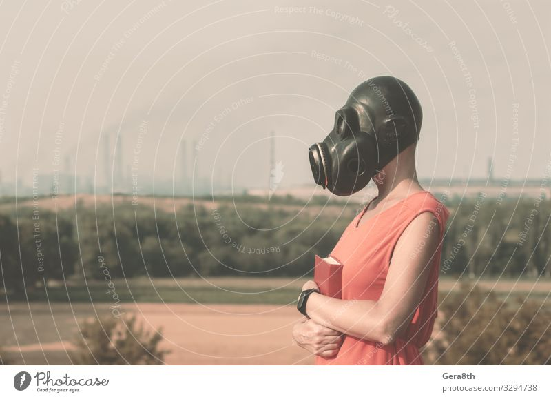 young girl in a gas mask in a red dress with a book Woman Human being Nature Plant Landscape Red Hand Tree Black Adults Environment Horizon Body Book Industry