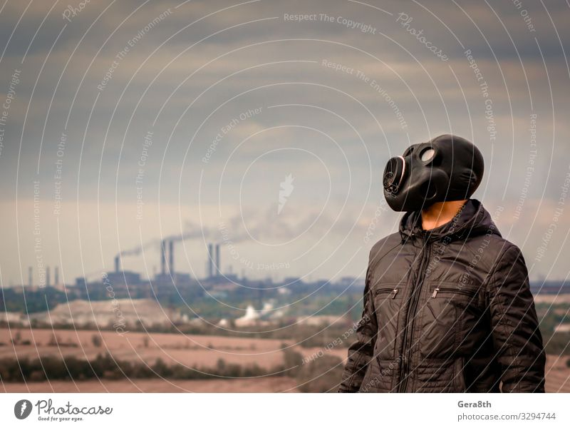 man in a gas mask amid smoke from factory pipes Human being Sky Nature Man Plant Landscape Tree Clouds Dark Black Adults Environment Gray Vantage point Dirty
