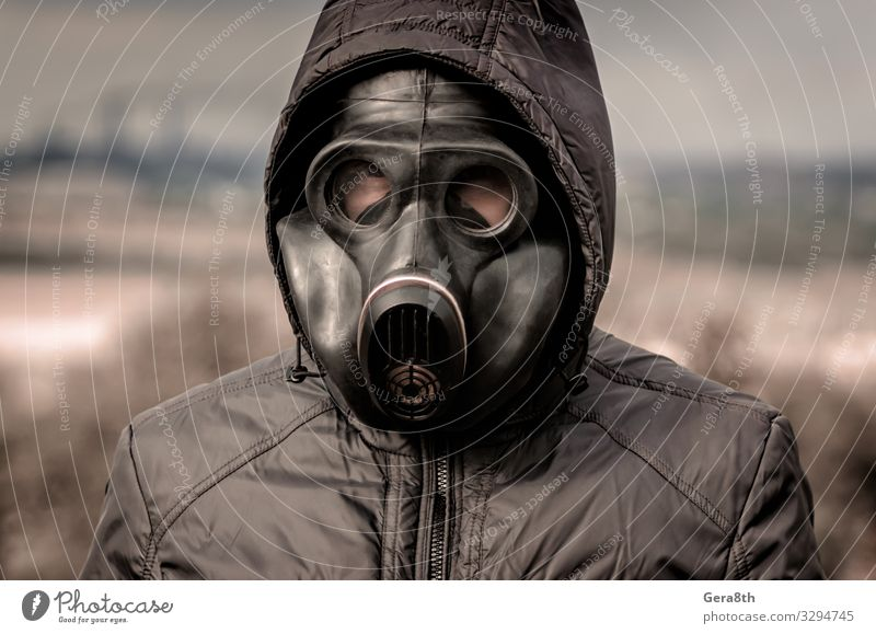 portrait of a man in a gas mask and a hood Factory Industry Human being Man Adults Environment Nature Landscape Plant Sky Clouds Tree Clothing Threat Dirty Dark