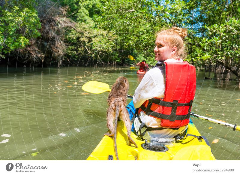 Young woman kayaking Lifestyle Exotic Joy Leisure and hobbies Vacation & Travel Tourism Trip Adventure Summer Summer vacation Island Hiking Sports