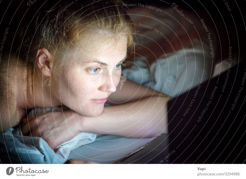 Young woman lying in bed with laptop Lifestyle Shopping Design Joy Beautiful Relaxation Leisure and hobbies Reading Computer games Living or residing Bedroom