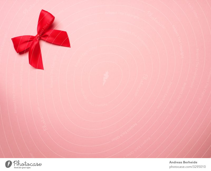 Red ribbon on pink background Style Valentine's Day Birthday Decoration Bow Love Pink surprise above abstract anniversary Background picture beautiful beauty