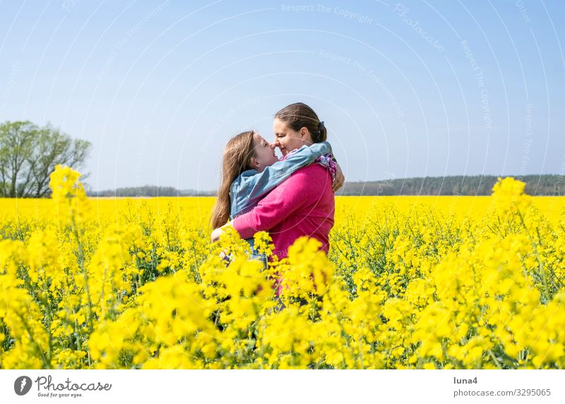 Mother and daughter in a rape field Joy Happy Contentment Vacation & Travel Child Girl Adults Family & Relations Nature Spring Blonde Laughter Happiness